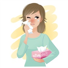 woman with kleenex dealing with common allergies and symptoms