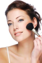 woman with beautiful skin applying mineral makeup